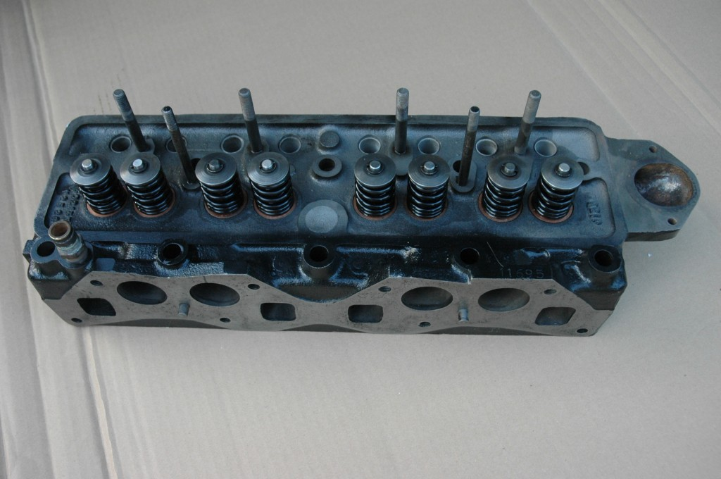 Reconditioned Triumph TR4A Cylinder Head with valves installed